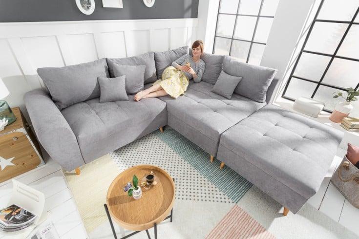 Design Ecksofa SCANDINAVIA 250cm hellgrau Nosag-Polsterung mit Hocker und Kissen